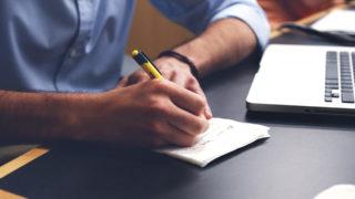 Close up of man taking notes